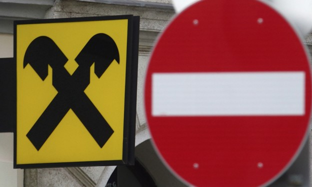 A Raiffeisen bank logo is pictured next to a traffic sign in Vienna
