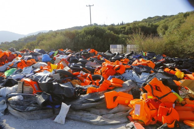 LESBOS, NORTH AEGEAN, GREECE - 2015/09/09: A huge pile of life jackets, other inflatable devices and inflatable rubber dinghies that were used by the refugees coming ashore. Hundreds of refugees, mainly from Syria, Iraq and Afghanistan are still coming to the Greek island of Lesbos on a daily basis, after making the dangerous trip from the nearby Turkish coast in small inflatable boats. (Photo by Michael Debets/Pacific Press/LightRocket via Getty Images)