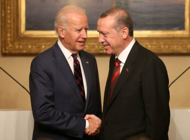 U.S. Vice President Joe Biden, left, and Turkish President Recep Tayyip Erdogan shake hands after a joint news conference in Istanbul, Turkey, Saturday, Nov. 22, 2014. Biden on Friday became the latest in a parade of U.S. officials trying to push Turkey to step up its role in the international coalition's fight against Islamic State extremists. (AP Photo/Emrah Gurel)